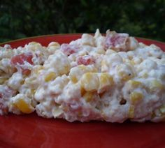 Rotel corn dip. One drained can white corn, 1 block cream cheese, and 1 almost drained can of Rotel. I put it in a glass bowl and microwave it one minute at a time till hot and melted. Serve with Scoop Fritos and keep warm in a small crockpot.