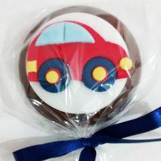 Pirulito de chocolate Meios de Transporte, embalado em celofane transparente e fita de cetim.  PESO APROXIMADO