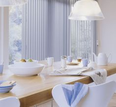 White always looks clean and fresh making it a perfect choice for a kitchen. Hunter Douglas Custom Vertical Blinds. ♦ Hunter Douglas window treatments