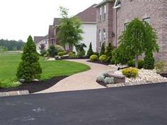 Front yard landscaping ideas - would swap the 2 trees flanking sidewalk