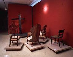 Upper class wooden chairs to stare at the wooden whipping post.  Again, Mining the Museum by Fred Wilson.