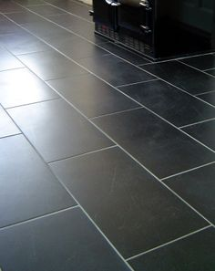 black and white 8 inch ceramic tile kitchen floor with epoxy grout