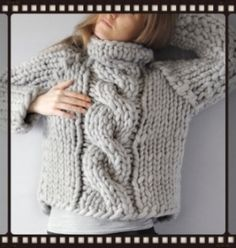 INSPIRED DESIGN Usually the entire center cable is only as wide as one of this sweater's singular knit stitches