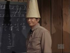 Little Joe fooling around with the dunce cap