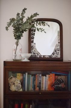 I love the vintage lawyer bookcase, milk glass bowl for trinkets, glass milk bottle, and old mirror for memories.