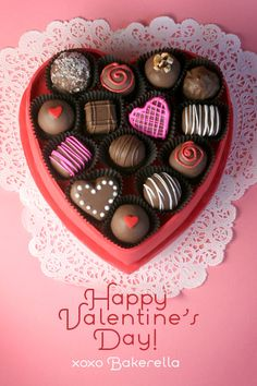 Box of Chocolates Cake- Heart shaped cake topped with chocolate truffles.  Tutorial!