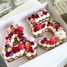 Fruit & Flower Birthday Tart  [butter cream or cream cheese frosting, pink merengue]