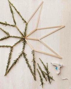 You only need popsicle sticks, rosemary + hot glue to DIY your own fragrant holiday star.