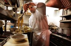 """Chef Paul DeCarli prepares linguine with clams and sausage at Decarli. Described in this artcile as """"rustic sophistication"""" - read what Broc Daniels has to say about his choice for 2012 Restaurant of the Year! We're proud!"""