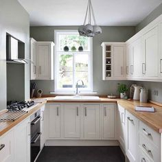 terraced house kitchen - though lots of cupboards, feels clean and minimal