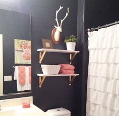 Navy, white and coral bathroom