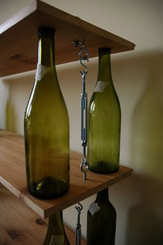 bookshelves...pretty nifty use for all those leftover wine bottles