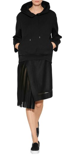 A cool modern choice for paring with statement sweatshirts, Iceberg's wrap skirt features pretty side pleating #Stylebop