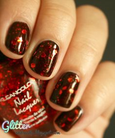 What's Halloween with out a little blood? These blood-red talons—dubbed Bloody Nails by Marie Le Borgne with Glitter and Nails—translate well from day to night this Halloween.