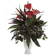 #Anthurium w/Mixed Greens and White Vase.  Here's an arrangement that takes multiple colors, shapes, and textures and combines them into one beautiful package. With soft, striking Anthurium blooms set high atop a cornucopia of mixed greenery, this Anthurium will be the most talked-about piece in your home or office décor. Complete with a classic white vase, it also makes a fine gift for that hard to buy for person. #silkflowers