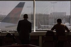 Travelers wait to board a Delta flight—not in the business class lounge