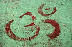 """The universal """"om"""" symbol. Om is a mystic syllable, considered the most sacred of mantras. Learn how to use mantras in Jane's meditation class starting 30 January 2013."""