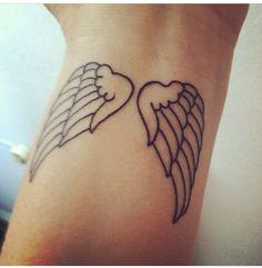 Angel wings on my left wrist. LOVE