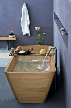 Interesting wooden bathtub.