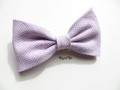 Lavender linen bow tie has subtle plaid pattern for a hint of color. Tangled Ties are handcrafted in high quality fabrics, using design and construction techniques that result in a timeless, classic look. Swatch available upon request. Bow tie is made from cotton/linen fabric and available in clip-on, prettied and self-tie styles. Also available in skinny or regular mens or childs neckties, suspenders or pocket squares. Our neckties are crafted traditionally with no fusible interfacing n...