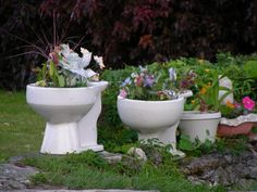 I've been wondering the best way to recycle all the old toilets we have been removing- toilet planter!