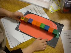 measuring pumpkins with blocks (this would be an easy activity to DIY)