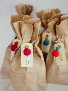 """Bright balls and brown paper bag wrapping. Love it from Audrey of """"This Little Street"""" : Bright balls and brown paper bag wrapping. Love it from Audrey of """"This Little Street"""" Simple Packaging, Pretty Packaging, Gift Packaging, Paper Packaging, Packaging Design, Creative Gift Wrapping, Creative Gifts, Wrapping Ideas, Paper Bag Wrapping"""