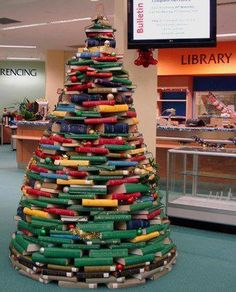 The book Christmas tree in the JCU Cairns Library. The staff at the Cairns library wishes you all a festive holiday season. Book Christmas Tree, Book Tree, Unique Christmas Trees, Christmas Tree Themes, Xmas Tree, Christmas Traditions, Christmas Greetings, Christmas Holidays, Christmas Ornaments
