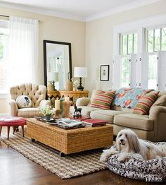Mix Rather Than Match The beauty of cottage style is its emphasis on comfort versus formality, so feel free to mix together pieces that you love to foster a collected-over-time look. In this living room, striped pink pillows pick up the perky blush of a retro leather-covered footstool, a classic cream-and-beige stripe fabric updates a hand-me down club chair, and a country-style wicker coffee table gets a modern boost from caster wheels.