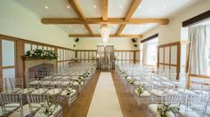 Music Room - this will be the room for the ceremony and later cleared for dancing and evening entertainment. We will be using the wooden brown chairs not the clear chairs.