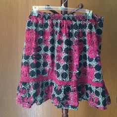 Pure energy skirt Pure energy pink and black skirt! Elevator wait with knitted boarder at the knee. Pure Energy Skirts