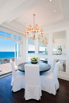 Great use of mirror in wainscoting to reflects more of the view and light. Retractable doors - view