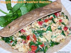 Healthy Breakfast Burrito with Scrambled Eggs, Spinach and Tomatoes