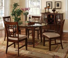 glass kitchen table sets with flower vase and decorative plant also carpet and cabinet