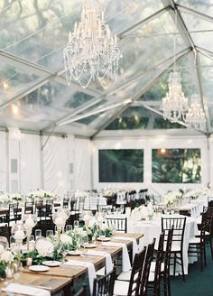 Guests then entered a clear tent where they were able to dine under the stars at long banquet tables lined with lush green table runners accented with white blooms. Wedding Decorations, Miami Wedding Venues