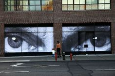 Two empty retail spaces were used for JR's installation in Manhattan. The images are of Native American's eyes and were submitted by photographers from North Dakota.
