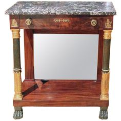 French Empire Console with Marble Top | From a unique collection of antique and modern console tables at https://www.1stdibs.com/furniture/tables/console-tables/
