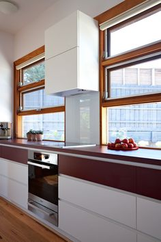I'm a fan of windows above kitchen benches rather than splash backs