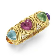 A DIAMOND, MULTI-GEM AND GOLD CUFF BRACELET, BY BVLGARI  The sculpted 18k gold cuff bracelet set with a heart-shaped cabochon citrine, aquamarine, pink tourmaline, green tourmaline and amethyst, with circular-cut diamond detail, mounted in 18k gold, 2¼ ins. diameter, 1 in. width Signed BVLGARI, no. C2741-2