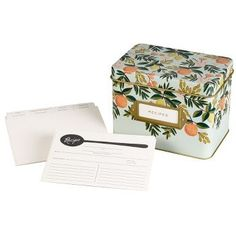 A vintage-inspired tin recipe box that is as delightful as your culinary creations. Comes with 12 letterpressed dividers and 24 recipe cards (4 x 6). Features gold accenting and interior and a gold