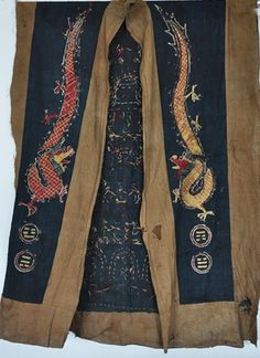 YAO Shaman robe from the hilltribes of the Golden Triangle (19th c.) contains ritual motifs. Some are symbols of potency and others are symbols of ancestors who were looked upon as protective gods.120cm length; 88cm shoulder width