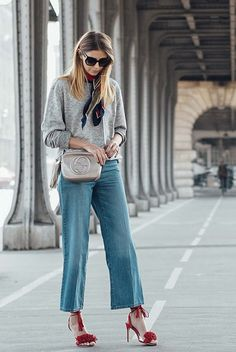 fall / winter - fall outfits - street style - street chic style - casual outfits - grey sweatshirt + silk scarf + red tassel heeled sandals + denim culottes + black sunglasses + beige tassel shoulder bag