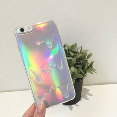 Super cute holographic iridescent style 3D Melting Ice Cream iPhone Case.  The holographic cardboard part sits behind the actual case, which is clear and soft TPU.