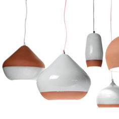 Tactile and organic, these handmade pendants combine kiln-fired terra-cotta with a shiny, white porcelain glaze.    Read more: http://www.dwell.com/products/terracotta-pendants.html#ixzz1sFRVmFzN