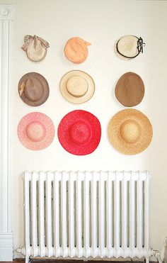 Julia Topaz. wall of charming hats