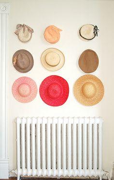 Julia Topaz. wall of charming hats