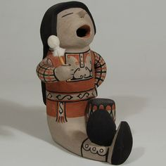 """#adobegallery #CochitiPuebloPottery #SouthwestIndianPottery - Cochiti Figurine of a Seated and Chanting Drummer. Buffy Cordero Suina (1969- ) #BuffyCorderoSuina Category: #Figurines Origin: #Cochiti #Pueblo Medium: clay, pigment Size: 7-1/8"""" height x 5-1/2"""" depth x 4-3/4"""" width Item # C3688.54"""