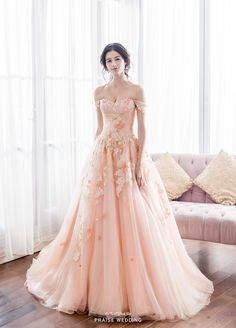 Peach is the new pink! This sweet peach off-the-shoulder gown from Anovia featuring delicately feminine embellishments shows a perfect fusion of whimsy, romance and elegance! » Praise Wedding Community