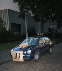 artist pimps out strangers cars at night with cardboard and tape