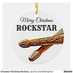 Beautiful drumming Christmas ornament features a pair of drum sticks and the caption Merry Christmas Rockstar. Perfect gift idea for musicians, music lovers and drum enthusiasts! Check out www.drumjunkiegraphics.com for more great drummer merch and musician gifts - all designed by a drummer! #drummerchristmas #musicianchristmas #drumsticks #drumjunkie